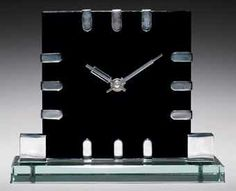NICKELLED BRASS AND GLASS TABLE CLOCK / BY JACQUES ADNET, CIRCA 1930