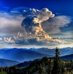 What gorgeous clouds above the beautiful cool mountains.