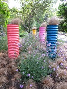 """repurposed culvert pipe (18"""" diameter) with some paint becomes instant containers"""