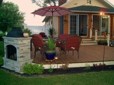 Cute, simple deck with fireplace ~ love this for my little cottage!