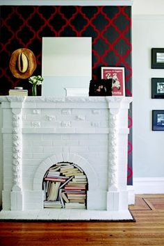 stylish. refurbished fireplace filled with books!