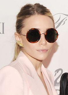 round sunglasses, messy ponytail, pink blazer