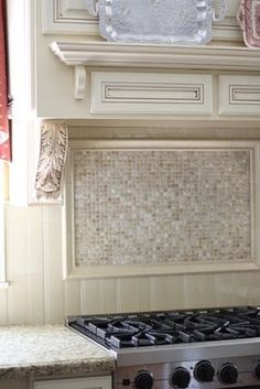 next project of many for the apartment! framed backsplash to go above our sink in the kitchen....