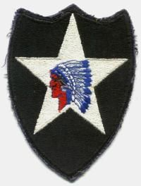 """Nickname:   Indian Head .......   Shoulder Patch: A red faced Indian Head on a white star, super-imposed on a black shield .......  Slogan: """"Second to None."""" .......  Source of Division: Regular Army.......  History:    Organized: Bourmont, France,  Aug., 1917. Actions: Chateau Thierry, St. Mihiel, Meuse-Argonne, Blanc Mont and Soissons .......  Training:   Airborne training, Ft. Sam Houston, Tex., Sept. to Nov., 1942; winter training Camp McCoy, Wis"""