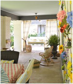"Front Porch Decorating Ideas from Grace Mitchell of A Storied Style. We love the simple ""flower wall"" she created with her children."