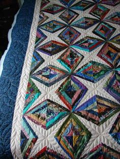 This is a scrap quilt called Diamonds are forever.  It was made by 'Prairie Quilter; from 'The Quilting Board' Quilted by Charisma.