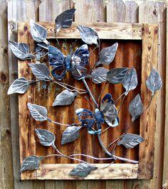Stainless Butterflies On Rusty Metal