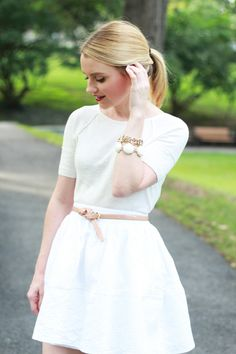 Blogger Poor Little It Girl dresses up her Gap elbow-sleeve sweater with a white jacquard skirt.