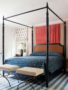 Jacques Adnet stools sit at the foot of a Whitley four poster bed from Hollywood at Home. PHOTO: Sam Frost.