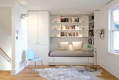 Use built-in furniture to make the most of a small space This daybed pulls out into a queen-size guest bed in a snap.