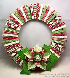 Clothes Pin Wreath #SU - use DSP or Washi tape - This cute Christmas wreath is made using clothespins. Because the wreath uses clothespins pinned to a wire frame, you can decorate the other side of the clothespins for a different season. When it's time to change your decorations for a different holiday, you flip the clothespins around and you have a wreath ready for your next event. I like the idea of using the same wire frame and changing out the clothespins.