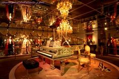 Liberace in gold piano