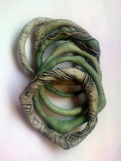 Organic textured bangle bracelets made from polymer clay by Sona Grigoryan. I love the colors and textures here.
