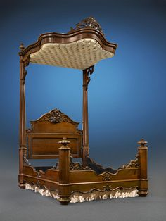•This exquisite half-tester bed is the epitome of American Victorian excellence   •Attributed to the great Prudent Mallard, this rare bed is crafted of rosewood and mahogany   •Magnificent carving informs the entirety of this antebellum treasure   •Provenance: North Carolina Private Collection   •Circa 1850