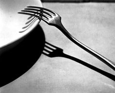 "André Kertész: Fork, Paris, 1928   When Alfred North Whitehead delivered the Lowell Lectures in 1925, he said, ""There is no substitute for the direct perception of the concrete achievement of a thing in its actuality."" Photographers, then and now, tend not to agree with this wisdom, because their business is the making of substitutes. For example: Kertész knew that if we set ourselves the task of looking at a fork, we would not see it with the elegance, grace, and subtlety that ..."