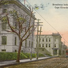 Looking west on Broadway in Cape Girardeau, 1915.  The electric trolley car lines ran in Cape Girardeau from 1905-1934, and the original route was a loop of the downtown area.  Broadway looking West, Cape Girardeau, Mo. :: Postcard Collection