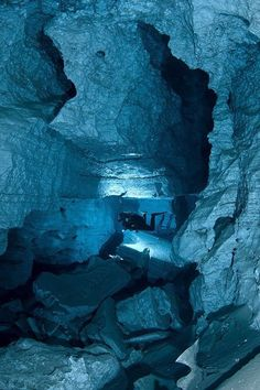 Orda cave in Russia the world's largest underwater gypsum cave. Enlarge to see diver.