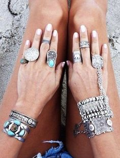 boho chic silver & turquoise stacked bracelets with gypsy inspired chain slave bracelet & modern hippie rings. FOLLOW this board now > http://www.pinterest.com/happygolicky/the-best-boho-chic-fashion-bohemian-jewelry-gypsy-/ for the BEST Bohemian fashion trends for 2015.