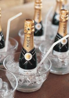 Mini champagne bottles for the bridesmaids while getting ready....so cute