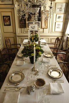I like the detail of the trim on the wall in the dining room.  I think it adds elegance to a formal room.