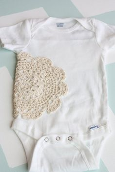 DIY ONESIE.  I think I would even use a bright colored doily or dye the onesies with a bright color.