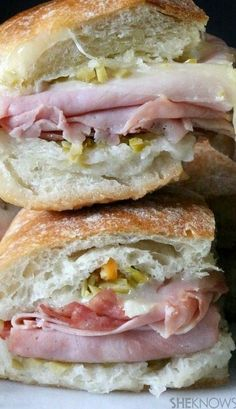 Mini Muffuletta Sandwiches filled with Ham, Salami, Provolone Cheese and a Special Olive Salad and Parmesan Cheese Dip.