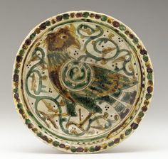 Afghan bowl from the 12th-13th centuries, the Seljuq period during which what is today Afghanistan was ruled by the Seljuq Turks.  The bowl is earthenware incised and painted with polychrome glazes (Museum Code: F1944.49 | Photograph and description taken from Freer and the Sackler Museums.)