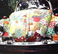 The inventor Jan Wetstone of Modge Podge decoupaged this VW bug with bed sheets!