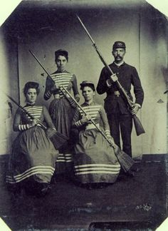 ca. 1890's, [portrait of a soldier among several women with brooms]