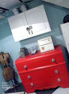 Love this red tomato color on the waterfall dresser!
