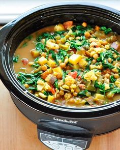 Curried Vegetable and Chickpea Stew: Creamy and mild, this simple curried soup is full of tender fall vegetables and the warming flavors of ginger and garlic. #crockpot #slowcooker