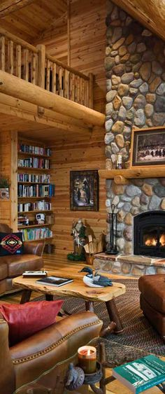 Simulated river rock faces the floor-to-ceiling wood-burning fireplace in this rustic great room.