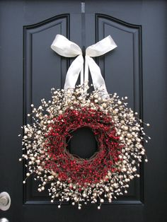 Lovely❣—baby's breath, red berries & white ribbon Christmas wreath.