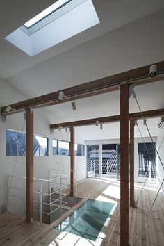"""Takeshi Hamada is the man responsible for this modern beauty titled House A. Located in Osaka, Japan, this home sits on a 56-square-meter plot of land extending three floors up. There is a room within the house that is specifically used as a space for """"hobbies."""""""