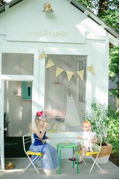 I'm obsessed with this playhouse! I wish I had a big enough yard to have one for this girls....maybe someday!