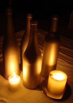 DIY Gold painted wine bottles