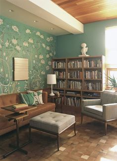 teal walls and mid-century wood furnishings are so inviting