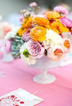 pink, peach, and orange floral arrangement orang floral, milk glass, color, low centerpieces, palm springs, peach, glass containers, floral arrangements, flowers