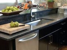 Black quartz counter tops. More affordable, more durable, and just as beautiful as granite IMO.