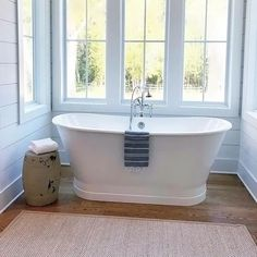 Windows are really nice surrounding the stand-alone tub
