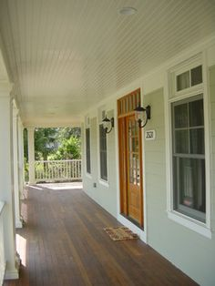 #porch #colonial #columns painted beadboard on ceiling with recessed lighting, and wood floor porch