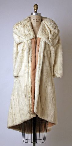 ~Evening cape House of Paquin  (French, 1891–1956) Date: fall/winter 1930–31 Culture: French Medium: fur, silk~