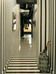 Black and white striped painted floor and walls in hallway