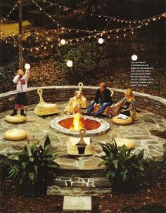 THIS is the fire pit and seating area of my dreams.  Want this in the front yard strategically partly surrounded by tall, thick bushes.  It could kind of look like a courtyard  MY neighbors would be ok with that.  : )