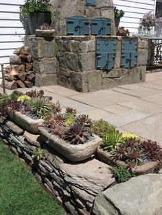 Hypertufa containers with succulents and thymes on a rustic bluestone patio - part of a larger landscape design project.
