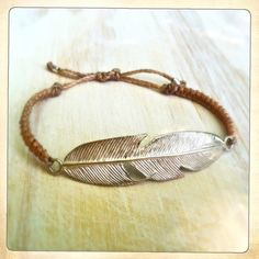 Love this nude color with a handmade sterling feather