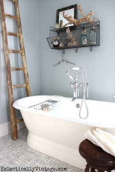 Dress up the bathroom with fun accessories like this manzanita branch from HomeGoods that looks like driftwood! eclecticallyvintage.com #HappybyDesign #HomeGoodsHappy #sponsored