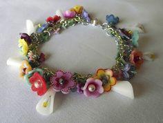 Shrinky Dink Charm Bracelet bead, jewelry crafts, charm bracelets, flower bracelet, shrink plastic, flower tutorial, diy bracelet, plastic flower, shrinki dink