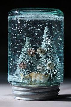 Homemade snowglobe also make mini bottle snowglobe charms with mini bottles: http://www.ecrafty.com/c-517-mini-glass-bottles.aspx #ecrafty