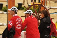Medal for best warm up jackets? Team Canada, modeled here by Ian Millar | ProEquest photo